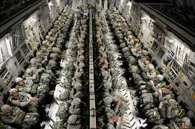 soldiers packed in c130